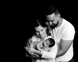 Stunning black and white photograph of mam, dad and newborn by Treasured Moments photography