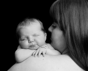 Newborn baby sleeping on mam's shoulder by Treasured Moments Photography